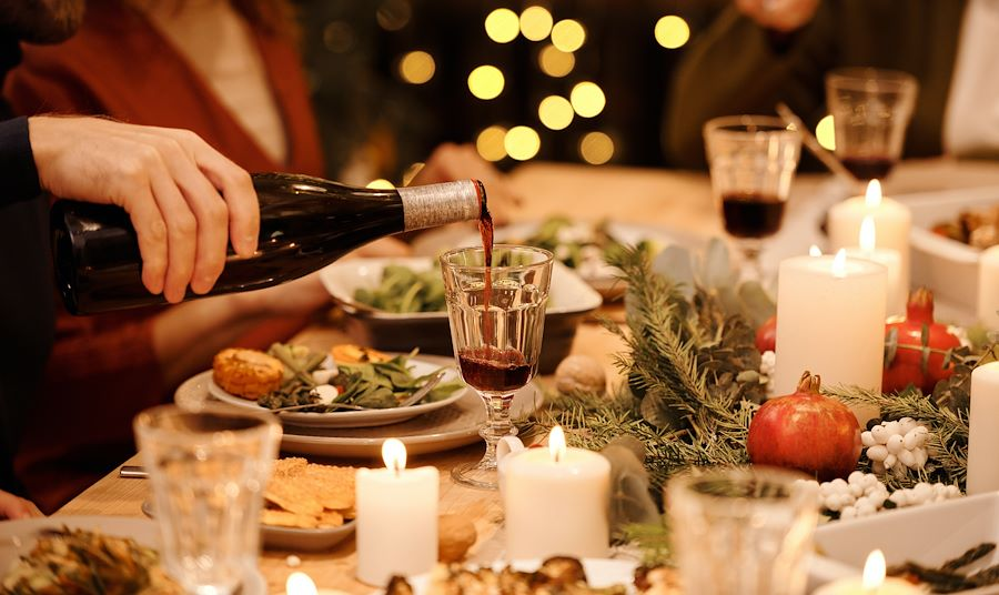 Dinner table with food and wine